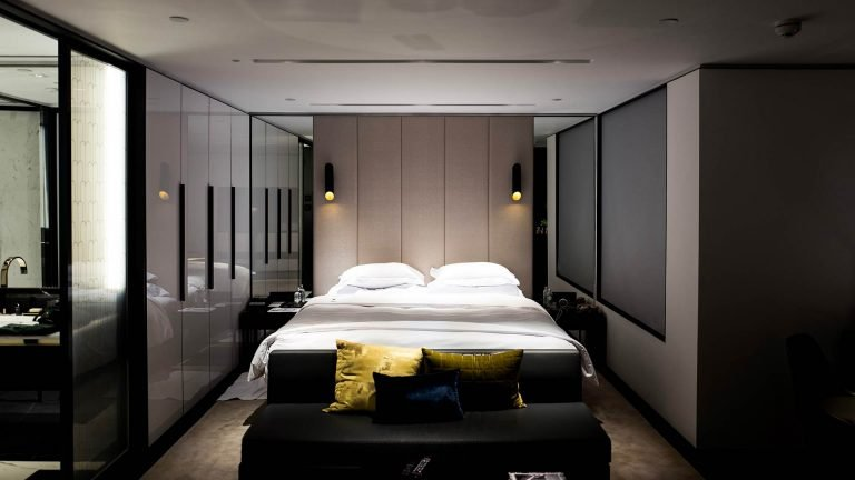 Hotel room with a king bed and semi-dark lights