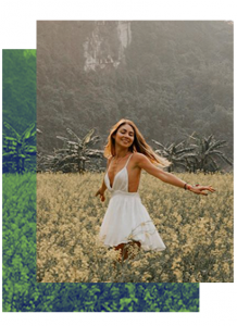 Woman breathing fresh air in the field in white dress. Happy, enjoying the day.