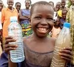 african boy holding bottle of waters